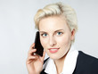 Beautiful woman calling with mobile phone in the office