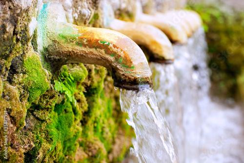 Leinwanddruck Bild brass fountain water source spring