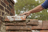Tiler Fits Ridge Tile On Roof