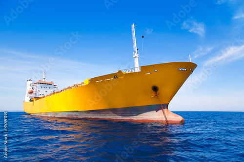 Anchor cargo yellow boat in blue sea - 35891191