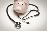 Piggy Bank and Stethoscope with Selective Focus