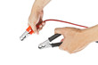 Human hand giving to charge battery