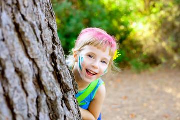 children little girl happy playing in forest tree