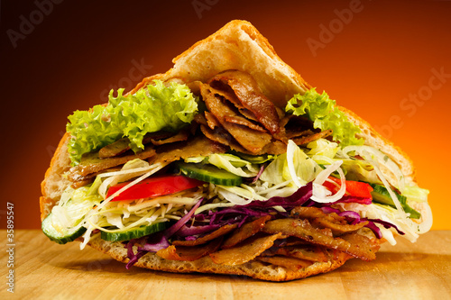 Fototapeta Kebab - grilled meat, bread and vegetables