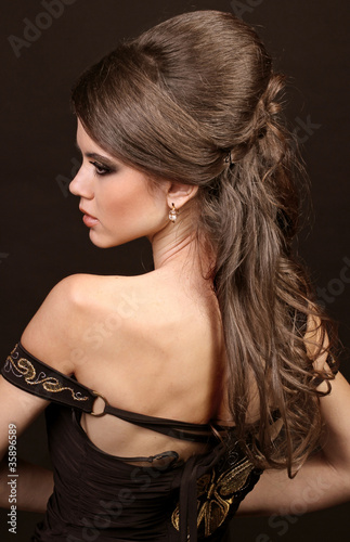 Beautiful woman with hairstyle luxuriant long hair. Beauty. Long