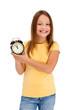 Girl holding alarm-clock isolated on white background