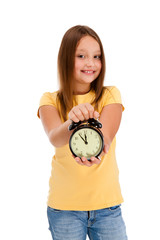 Girl holding alarm-clock isolated on white background