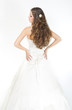 Long curly hair. Bride with hairstyle in wedding dress. Back vie