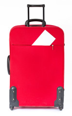 Suitcase with blank white ticket. Vertical side view. Over white