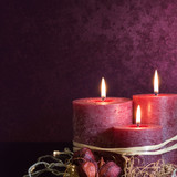 Three candles in purple