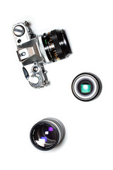 Analog film SLR camera and two lenses isolated on white