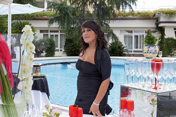 A young caterer during a swimming pool party