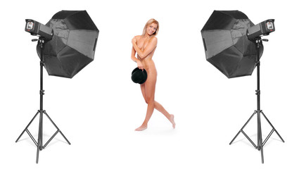 Funny image of a nude showgirl in studio.