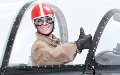 The pilot in cockpit of a vintage plane.