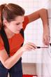 Female electrician installing a wall socket