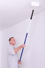 Painter redecorating room