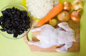 Raw chicken with prune and rice