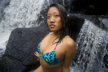 Asian woman at waterfalls