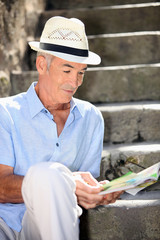 old man reading magazine