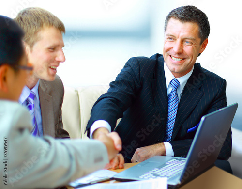 Business people shaking hands, finishing up a