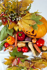 autumn composition of vegetables of leaves and the pumpkin