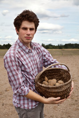 young agriculturist showing his crops