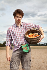 young agriculturist on the cultivated field