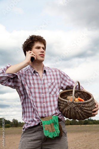 farmer speaking on the phone