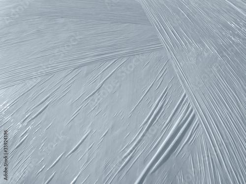 Leinwanddruck Bild wrapped white plastic foil detail