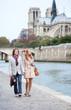 Romantic couple in Paris at the embankment