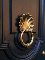 sea shell shaped brass door knocker