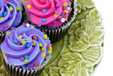 Three Cupcakes with purple and pink frosting and sprinkles
