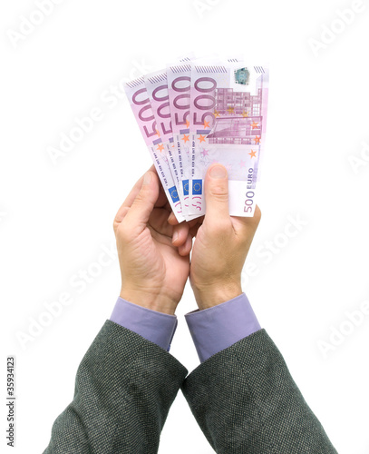 banknotes in the hands of men on a white background