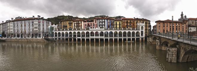 View of Tolosa, Oria river, town market and Santa Maria Church