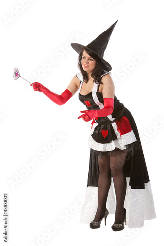 sexy girl in Halloween witch with wand