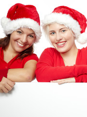 Pretty girls with santa hat has fun with copyspace