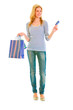 Full length portrait of attractive teen girl with shopping bags