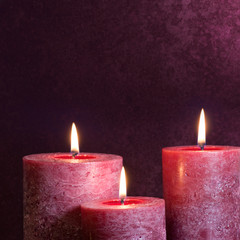 Candles on purple background