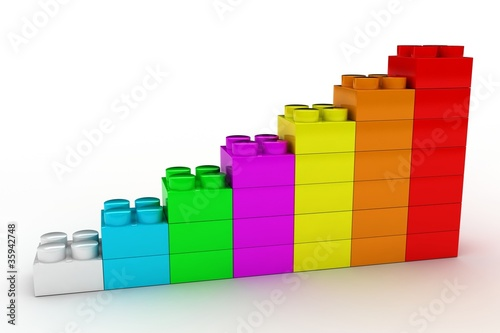 plastic construction background with colored  bricks on white