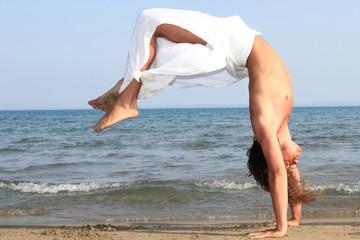 Capoeira dancer on the beach