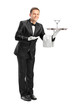 Waiter holding a tray with a glass of cocktail on it