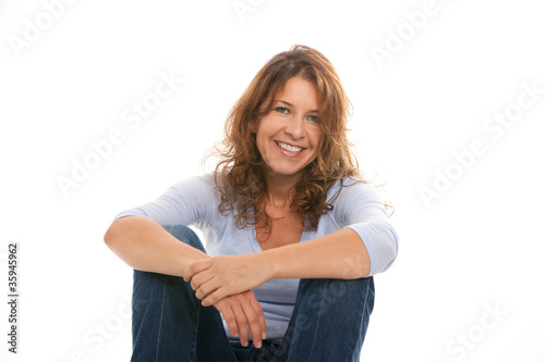 Attractive middle age woman on a white background