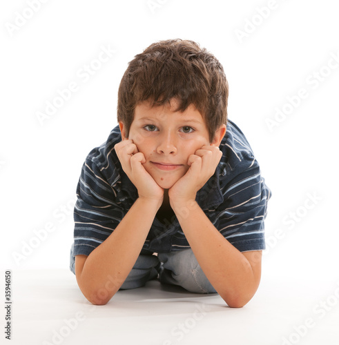 Cute thinking boy on a white background