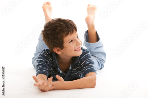 Cute happy boy on a white background
