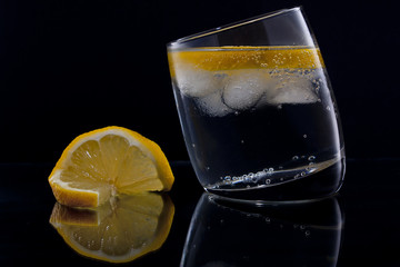 Gin and tonic with a slice of lemon