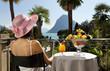 beautiful woman.on the terrace of prestigious hotel,