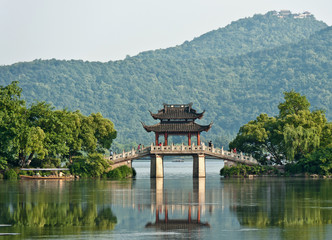 Old bridge over a lake, China