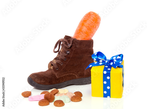 a shoe with a carrot and gifts and candy Dutch Sinterklaas feast