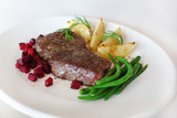 Sirloin with beetroot, beans and potatoes with rosemary on white