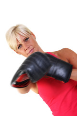 Attractive woman shadow boxing